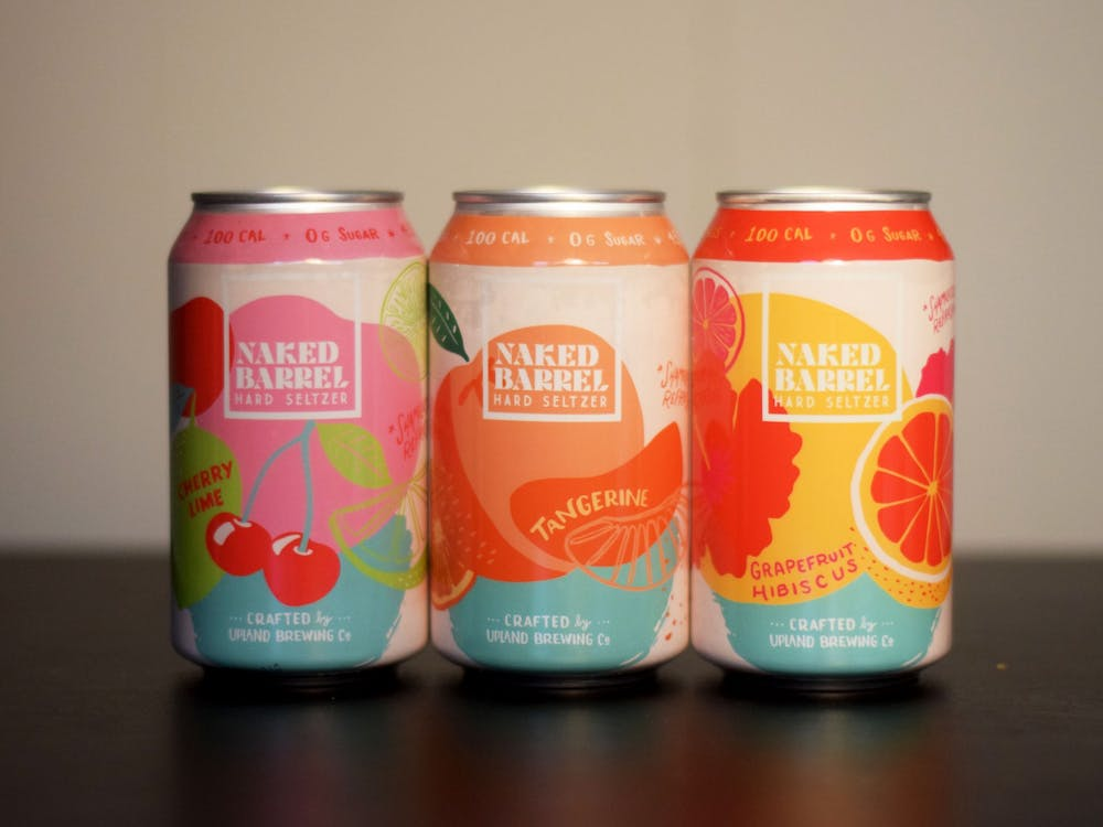 Three cans of Upland Brewing Company's Naked Barrel Hard Seltzer are lined up Wednesday in a student's house. Upland, located in several places around Indiana, launched its new seltzer brand in January.