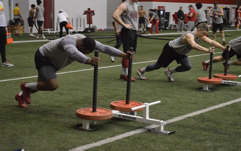 IU football players run through drills during practice in 2017 at John Mellencamp Pavilion. IU Athletics has announced its plan for fall sports to return to practice this summer.