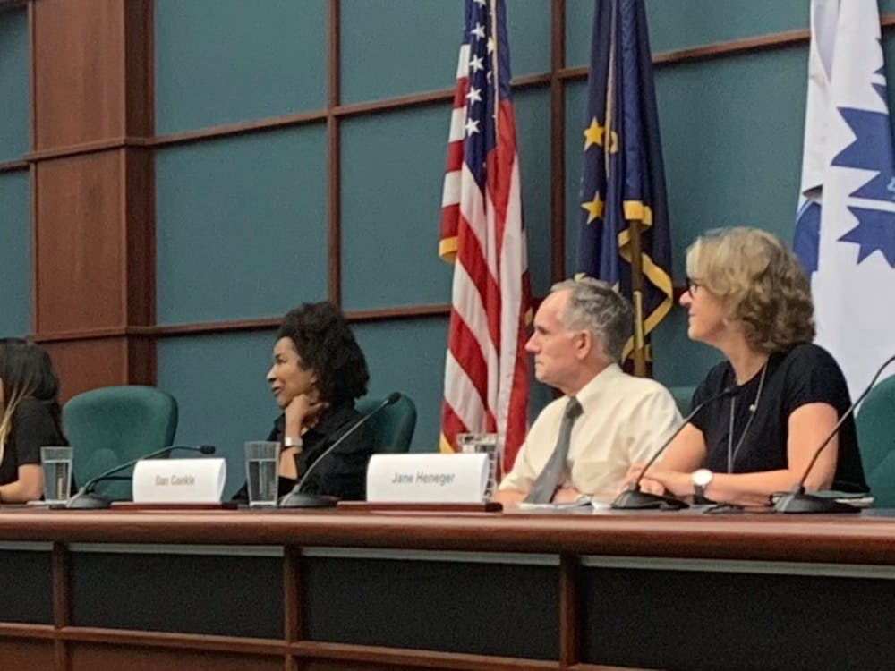 From left to right, Abby Ang, Jeannine Bell, Dan Conkle and Jane Henegar wait to speak June 11 in City Hall. The four spoke on a panel about potential legal issues for the Bloomington Community Farmers' Market regarding allegations that a market vendor is run by white supremacists.