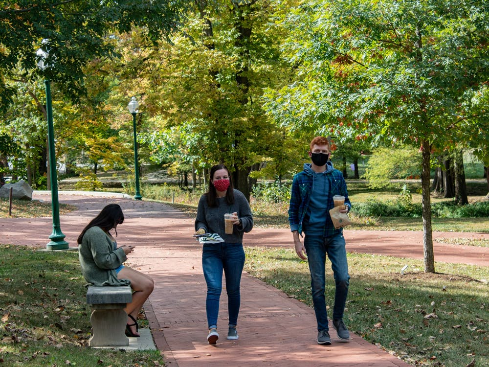 Students walk along a trail Oct. 15, 2020, by the Campus River near Dunn Meadow. A new IU study will test COVID-19 infection and transmission among vaccinated college students and is in need of 12,000 college students from various universities to participate.