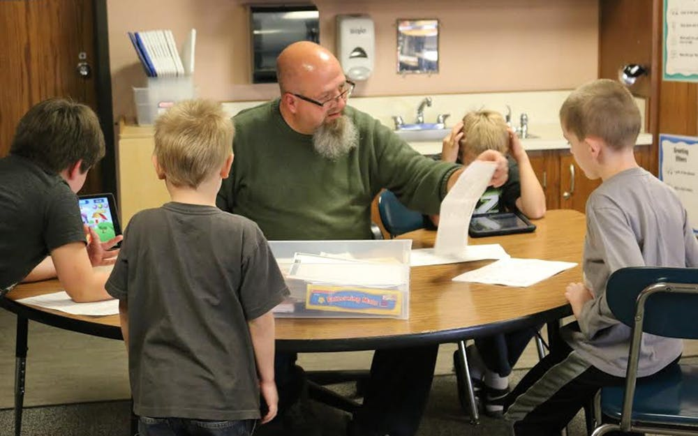 <p>Special education teacher at Highland Park Elementary School Kraig Bushey works with students on focusing skills to prepare them for traditional classrooms Oct. 13, 2016.There is a new bill in state legislature which would create a $150 million grant program, helping fund summer remedial programs to address learning loss from the pandemic. </p>