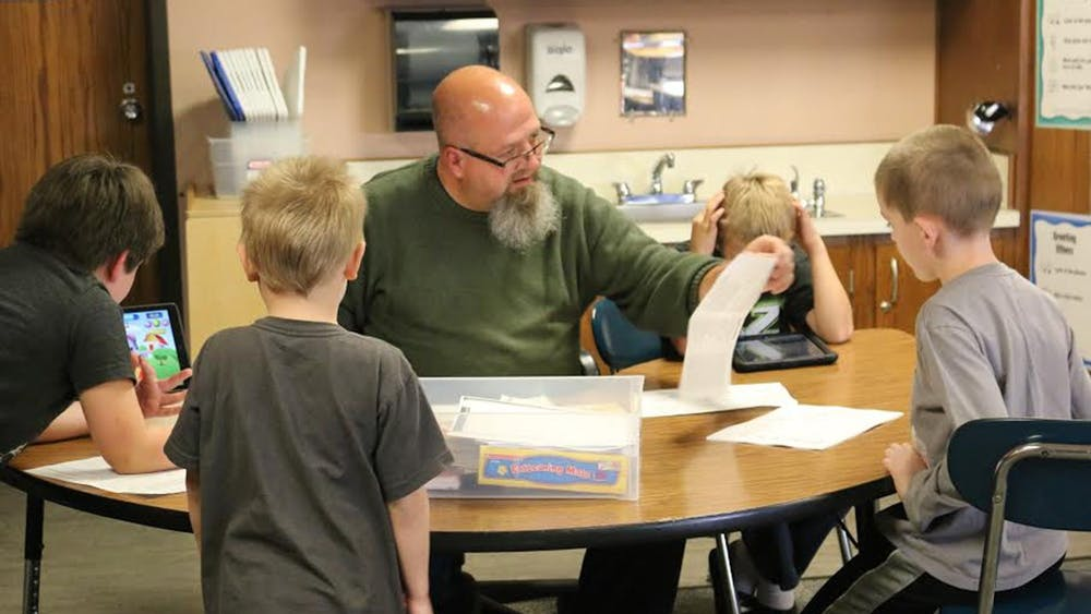 Special education teacher at Highland Park Elementary School Kraig Bushey works with students on focusing skills to prepare them for traditional classrooms Oct. 13, 2016. There is a new bill in state legislature which would create a $150 million grant program, helping fund summer remedial programs to address learning loss from the pandemic.