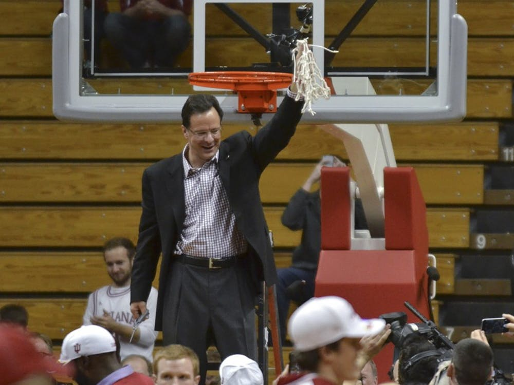 Head Coach Tom Crean holds the net after finishing the regular season on Sunday, March 6, 2016 at the Assembly Hall.
