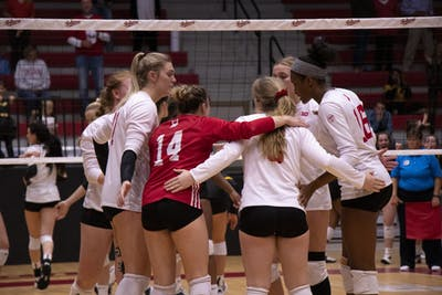 IU volleyball players confer between points during the fifth set against Iowa Oct. 26 at Wilkinson Hall. On National Signing Day, the IU volleyball program announced an eight-member 2020 class.
