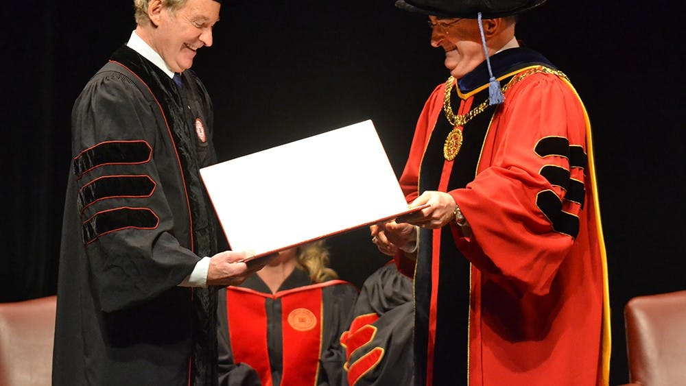 President McRobbie presents Kevin Kline with an Honorary Degree Monday at the IU Auditorium.