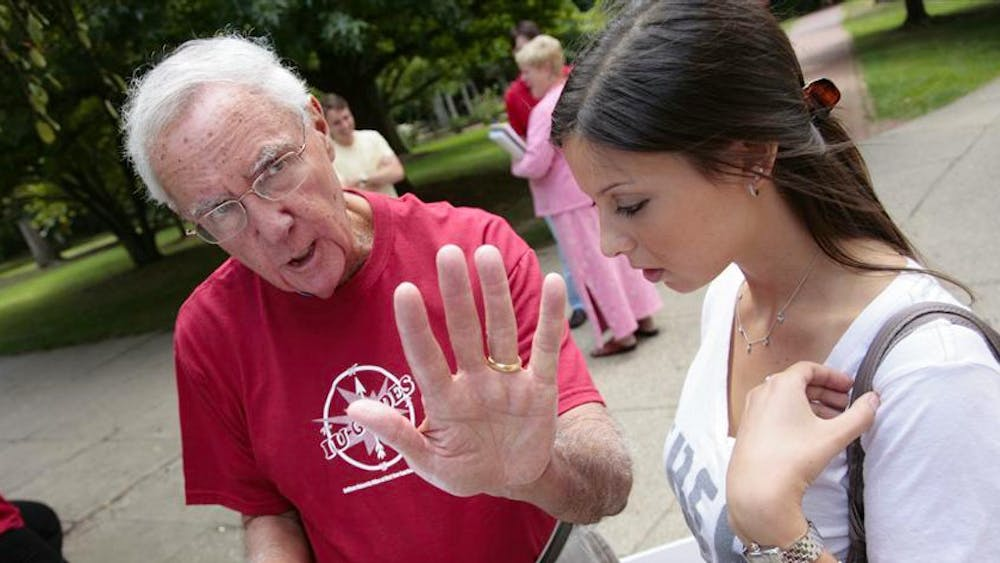 Ken Gros Louis assists then-freshman Madalyn Warshawsky during the first day of classes in 2009. Gros Louis died Thursday at the age of 80.