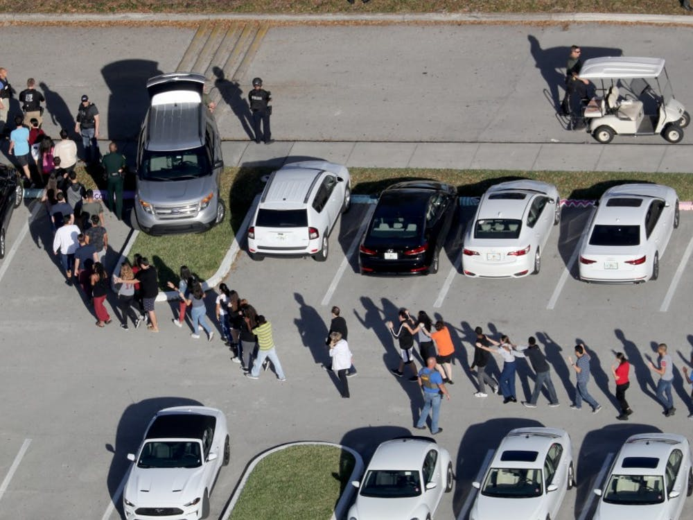 Students are evacuated by police out of Stoneman Douglas High School after a shooting on Wednesday, Feb. 14, 2018, in Parkland, Florida.