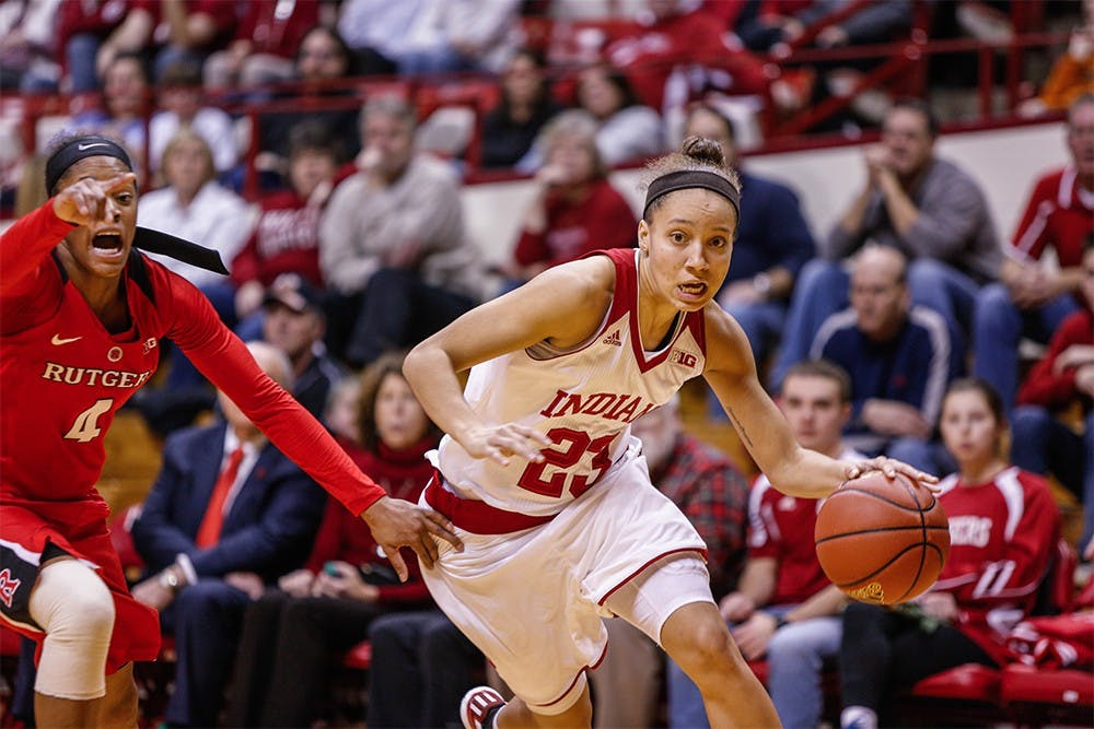 Junior guard Alexis Gassion pushes the ball up the court against Rutgers. IU defeated Rutgers 64-48 on Wedensday to improve their home record to 9-0.