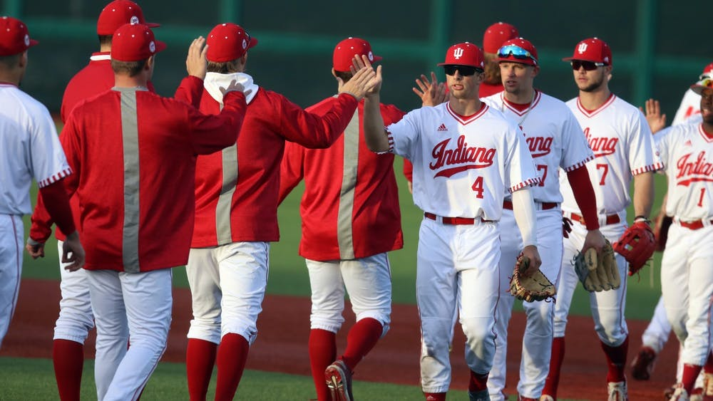 The IU baseball team high-fives after a 17-2 win over Purdue on March 4 at Bart Kaufman Field. IU will compete against the University of Evansville on Tuesday in Evansville, Indiana.