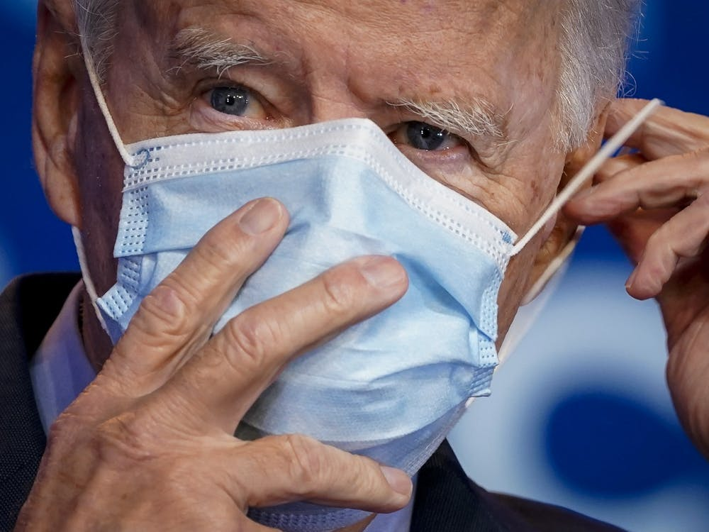 President-elect Joe Biden puts on his face mask Oct. 28 after making remarks about the Affordable Care Act and COVID-19 in Wilmington, Delaware. Biden was named president-elect Saturday.