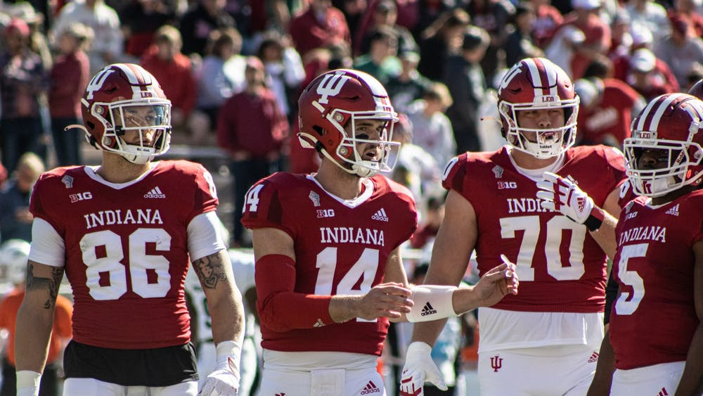 Junior quaterback Jack Tuttle gathers the offense against Michigan State on Oct. 16, 2021, at Memorial Stadium. Indiana football has scored one touchdown in three Big Ten games this season.