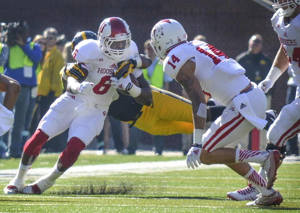Junior running back Tevin Coleman gets tackled in IU's game against Iowa on Saturday at Kinnick Stadium.