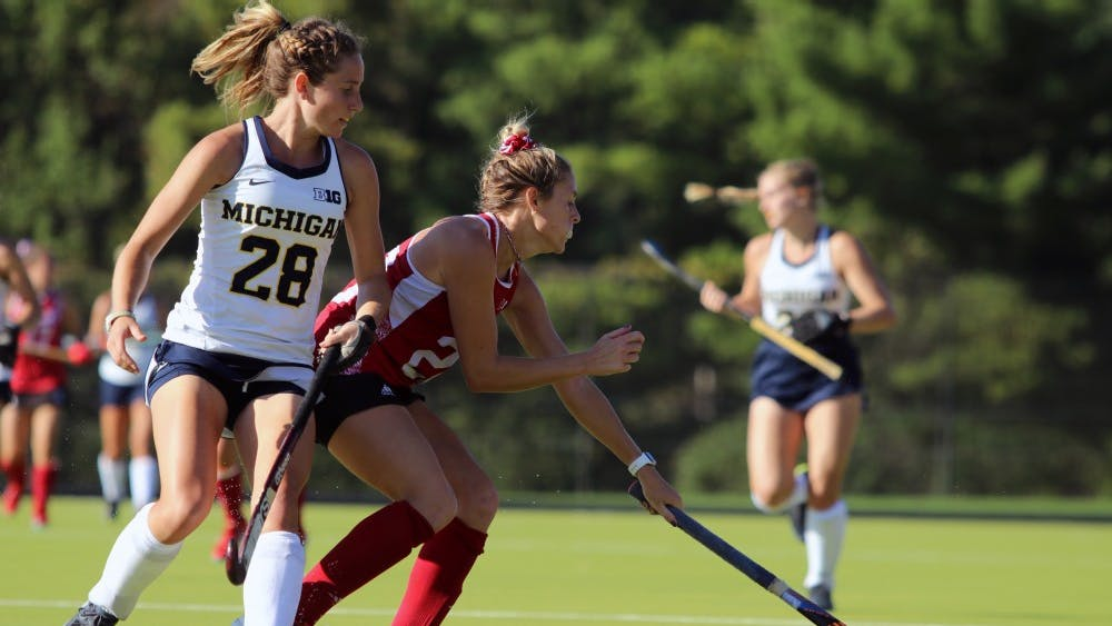 Senior forward Maddie Latino controls the ball against Michigan on Oct. 13 at the IU Field Hockey Complex. IU finished Big Ten play 0-8 after losses to Ohio State and Penn State this past weekend.
