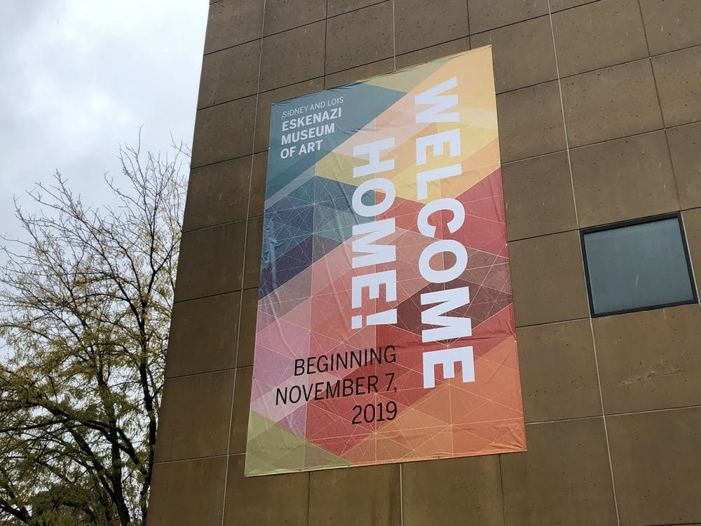 """A sign displaying the message, """"welcome home!"""" hangs Oct. 21 from the side of the Eskenazi Museum of Art. The museum will reopen Nov. 7."""
