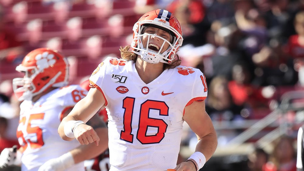 Clemson quarterback Trevor Lawrence celebrates Oct. 19, 2019, at Cardinal Stadium in Louisville, Kentucky. Lawrence is projected to be a first-round pick in the NFL Draft on April 29.