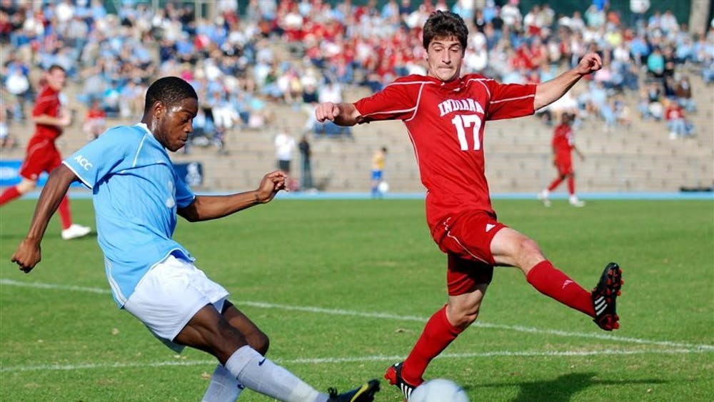 North Carolina's Alex Dixon kicks past senior midfielder Lee Hagedorn during the third round of the NCAA Men's Soccer Championship on Sunday in Chapel Hill, N.C. The Hoosiers fell to the fifth-seeded Tar Heels 1-0.