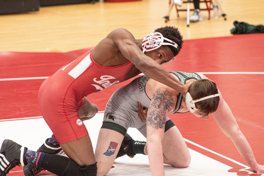 <p>IU sophomore DJ Washington and Michigan State redshirt senior Drew Hughes face off during their match on Feb. 6th at Wilkinson Hall in Bloomington. Washington won the match by major decision 16-3. </p>