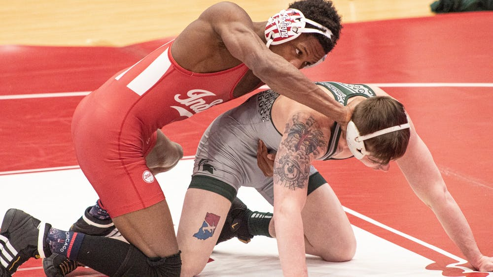 IU sophomore DJ Washington and Michigan State redshirt senior Drew Hughes face off during their match on Feb. 6th at Wilkinson Hall in Bloomington. Washington won the match by major decision 16-3.