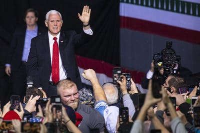 "Vice President Mike Pence takes the stage Dec. 18 during President Trump's ""Merry Christmas"" campaign rally in Battle Creek, Michigan."
