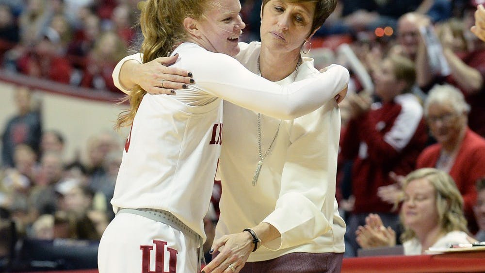 Senior guard Grace Withrow hugs head coach Teri Moren during the Senior Day game March 3 game against Purdue in Simon Skjodt Assembly Hall. Withrow scored IU's final point of the game on a free throw.