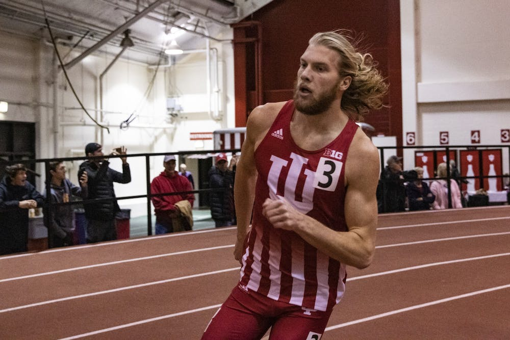<p>Junior distance runner Cooper Williams runs the second lap of the 600-meter race during the Gladstein Invitational on Jan. 25 in Gladstein Fieldhouse. Williams took second in the 600-meter during the Meyo Invitational on Feb. 7-8 in South Bend, Indiana.</p>