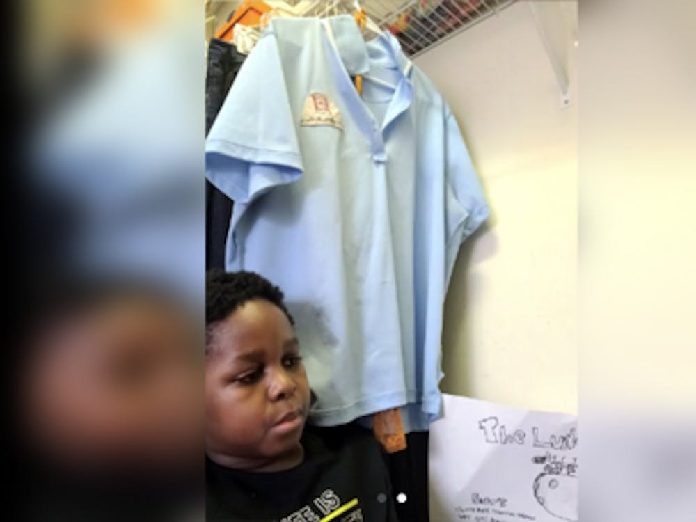 CJ Mason, 11, attends his classes in his mom's closet, which was converted into a home office during the pandemic. He is learning about citations and bibliographies.