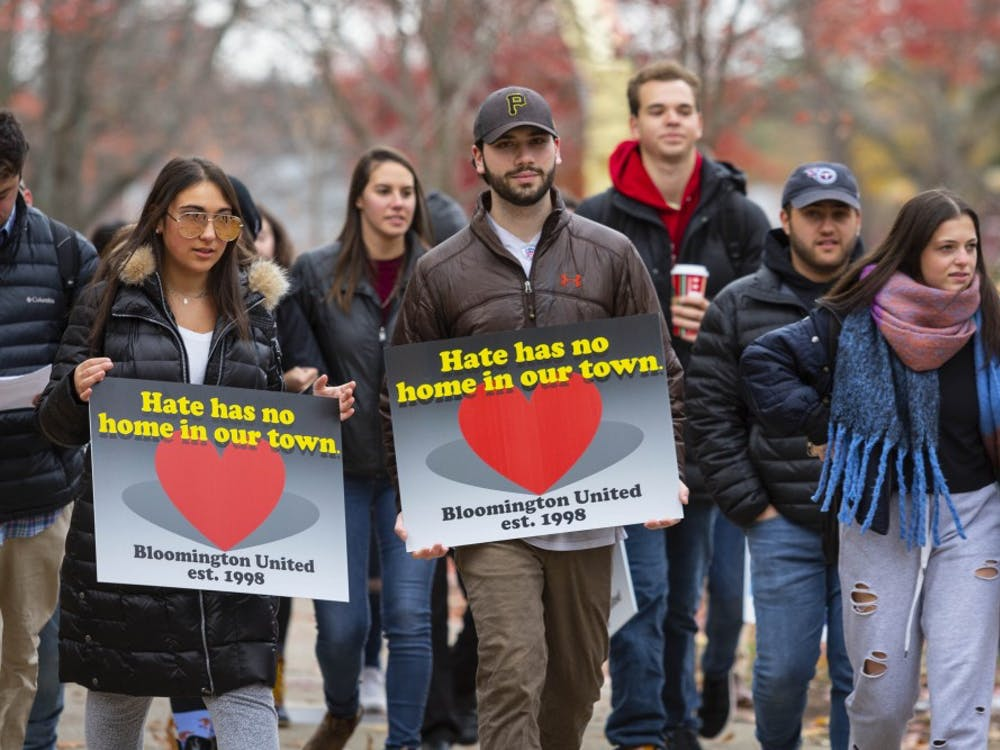 Protesters march Nov. 11, 2018, toward the steps of IU Auditorium during a march against hate.