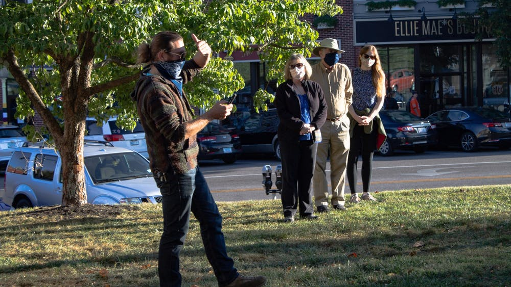 A man reads the mourner's kaddish, a Jewish prayer, at a vigil for Justice Ruth Bader Ginsburg on Sept. 20 outside of the Monroe County Courthouse. The vigil included prayer, song and speeches from participants.