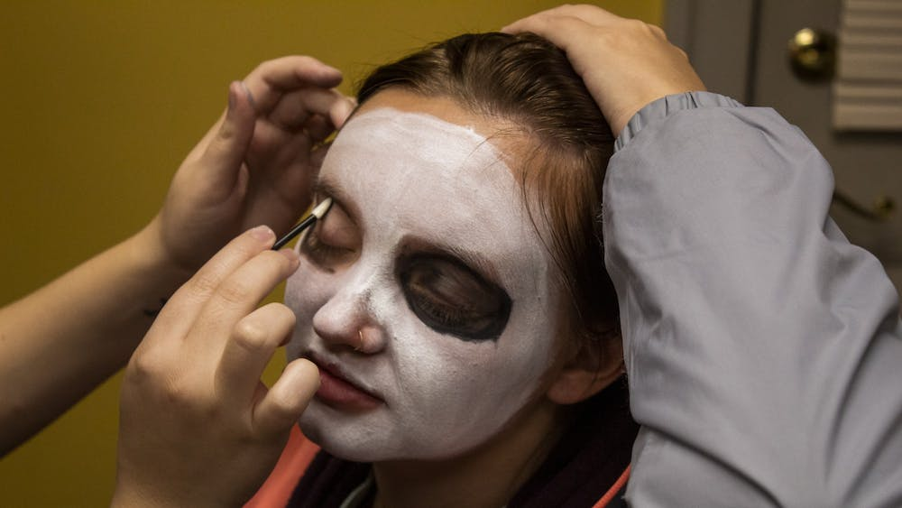 Senior Brittany Copeland gets her face painted Oct. 30 at La Casa Latino Culture Center.