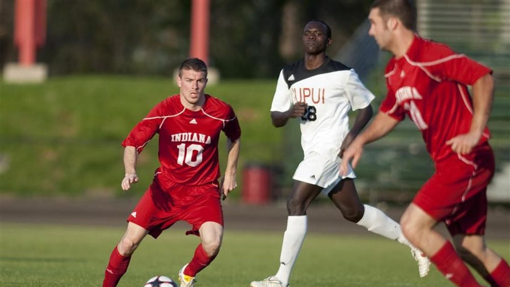 Junior midfielder Andy Adlard looks for a pass as sophomore forward Will Bruin (right) tries to run behind the IUPUI defense during the Hoosier's game against the Jaguars Wednesday at Bill Armstrong Stadium. Hoosiers tied the game 1-1.