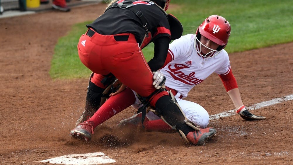 Then-freshman IU softball outfielder Taylor Lambert gets tagged out at the plate as she attempts to put IU's first points on the board April 18, 2018. IU will play in the Big Ten/ACC challenge Friday and Saturday against Duke University and Syracuse University in Durham, North Carolina.
