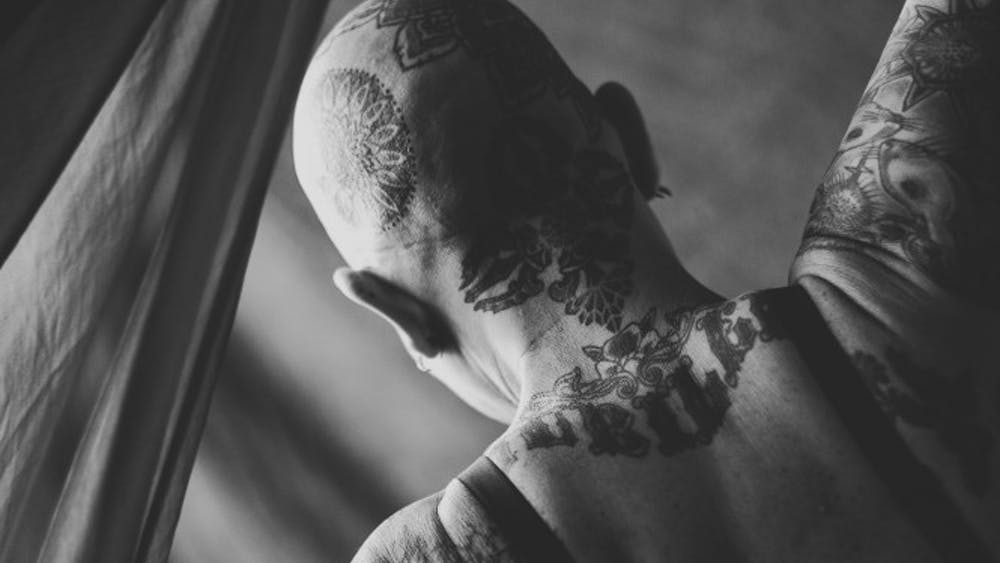 """Natasha Komoda is the founder of the photo project Femmeography. In January, """"Our Bodies, Our Choices,"""" an exhibit featuring photos from a calendar of tattooed Bloomington women, was displayed at the Blueline Gallery."""