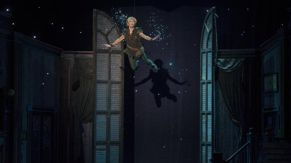 Peter flies onto stage Tuesday evening at the IU Auditorium. The show starred Cathy Rigby in her Tony nominated role of Peter Pan, the boy who refuses to grow up.