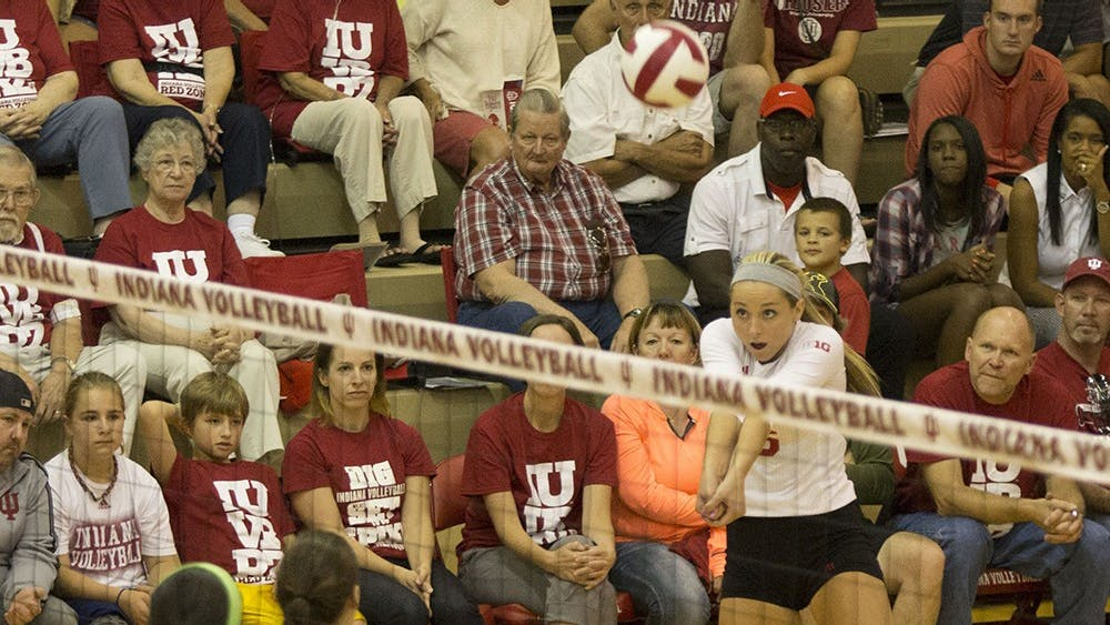 Junior Amelia Anderson bumps the ball over the net during the volleyball team's game versus Butler on Saturday night. The Hoosiers defeated the Bulldogs and went on to win the Hoosier Classic 2-1.