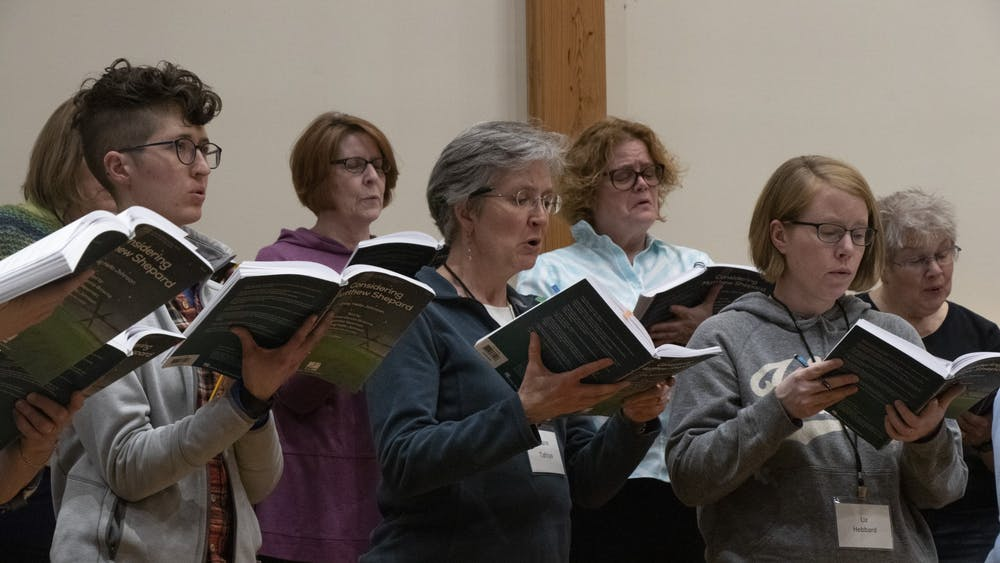 """Members of the Bloomington Chamber Singers rehearse a vocal piece March 3 at the Unitarian Universalist Church of Bloomington. The group is preparing for a performance of """"Considering Matthew Shepard"""" in May."""