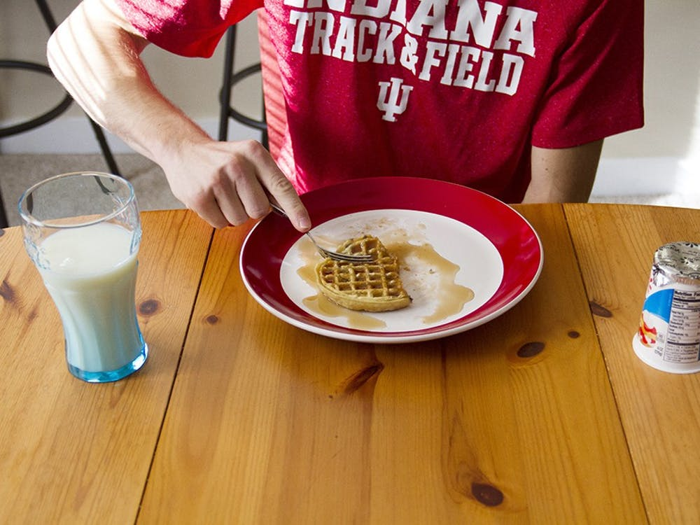 FROZEN BLUEBERRY WAFFLES. Kyle Overway, IU track and cross-country runner, usually has a quick bagel early in the morning during weekdays but enjoys a bigger breakfast on weekend, and made waffles smothered with syrup, a yogurt, and a large glass of milk.