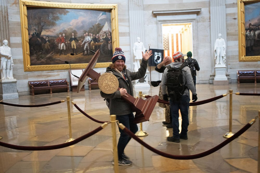 <p>A rioter takes the lectern of U.S. Speaker of the House Nancy Pelosi through the U.S. Capitol Building after a pro-Trump mob swarmed the building on Jan. 6 in Washington, D.C. Items were stolen and damaged by rioters, including furniture, windows and artifacts. </p><p></p><p></p>