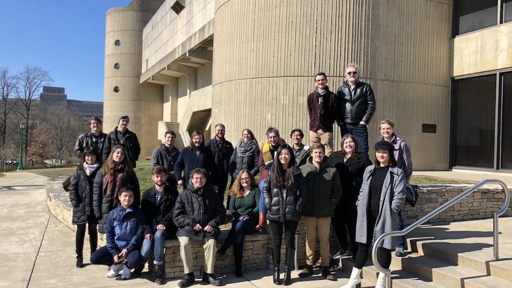 Members of the IU New Music Ensemble pose for a photo Feb. 14 outside the Musical Arts Center. The ensemble will perform at 8 p.m. on March 5 in Auer Hall.