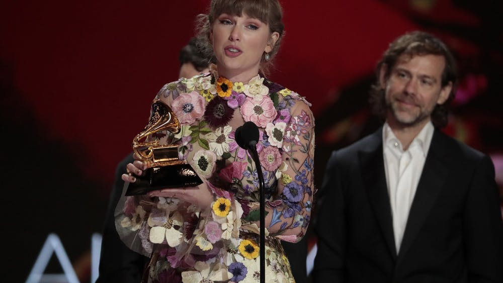 "Taylor Swift accepts the award for Album of the Year at the 63rd Grammy Awards on March 14 outside the Staples Center in Los Angeles. Swift released her new album ""Fearless (Taylor's version),"" a rerecorded version of her 2008 ""Fearless"" album, on April 9."