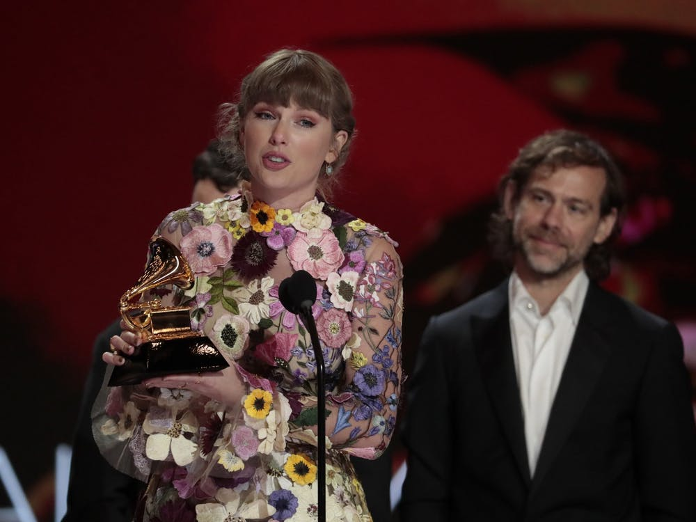 """Taylor Swift accepts the award for Album of the Year at the 63rd Grammy Awards on March 14 outside the Staples Center in Los Angeles. Swift released her new album """"Fearless (Taylor's version),"""" a rerecorded version of her 2008 """"Fearless"""" album, on April 9."""