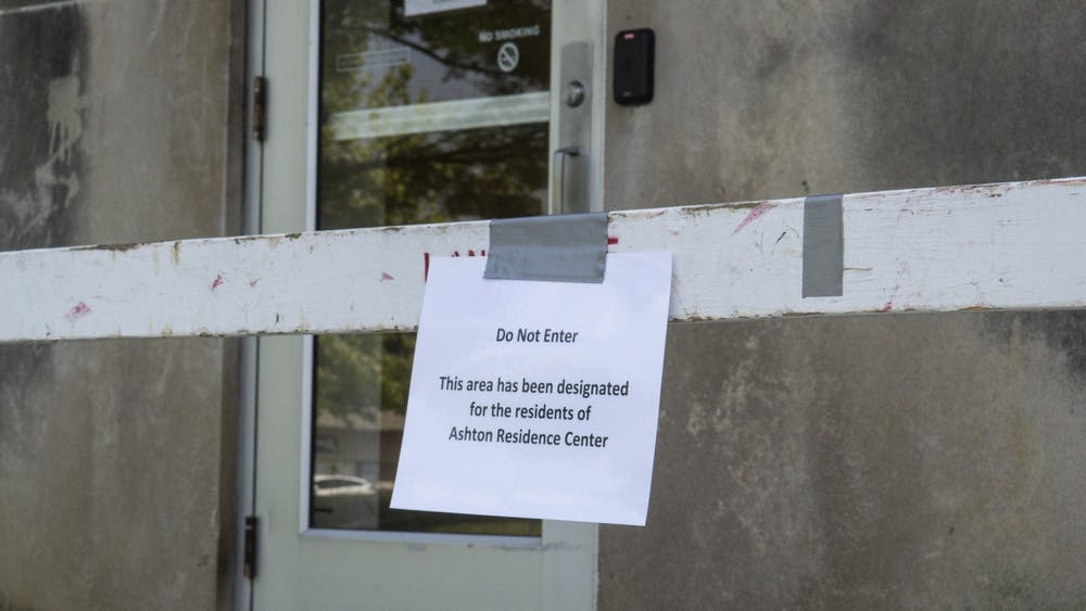"A sign that reads ""Do Not Enter"" is seen Sep. 10 taped to a barricade outside of Ashton Center. The IU quarantine housing at Ashton is under scrutiny for not having a strict enough protocol regarding residents entering and exiting the building."