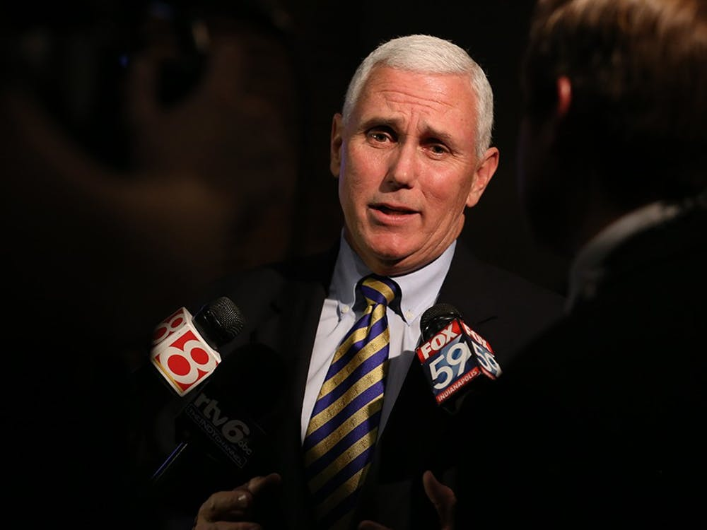 Gov. Mike Pence is interviewed by television stations at the Republican Election Night watch party in downtown Indianapolis.