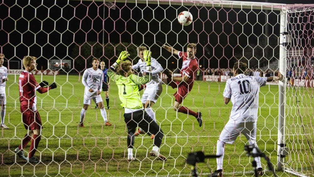 Senior defender Timmy Mehl heads the ball into the net to give IU a goal Oct. 16 at Bill Armstrong Stadium. IU defeated Butler 3-0.