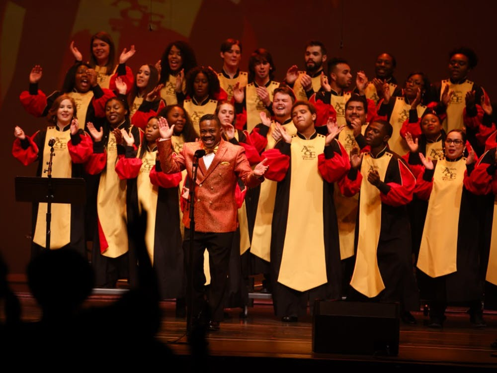 """African American Choral Ensemble Director Dr. Raymond Wise directs the ensemble during Potpourri of the Arts on Nov. 11, 2017, at the IU Auditorium. The African American Arts Institute will present the 25th anniversary, """"Potpourri of the Arts in the African American Tradition"""" at 7:30 p.m. on Nov. 10."""