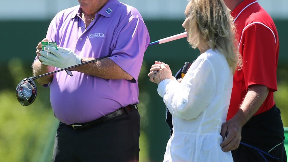 Fuzzy Zoeller, 1979 Masters champion, stops to sign an autograph on his way to the 10th hole at practice rounds ahead of the Masters on April 3, 2016, at Augusta National Golf Club in Augusta, Georgia. Zoeller owns Fuzzy's Vodka, which will be moving its production to Bloomington in November.