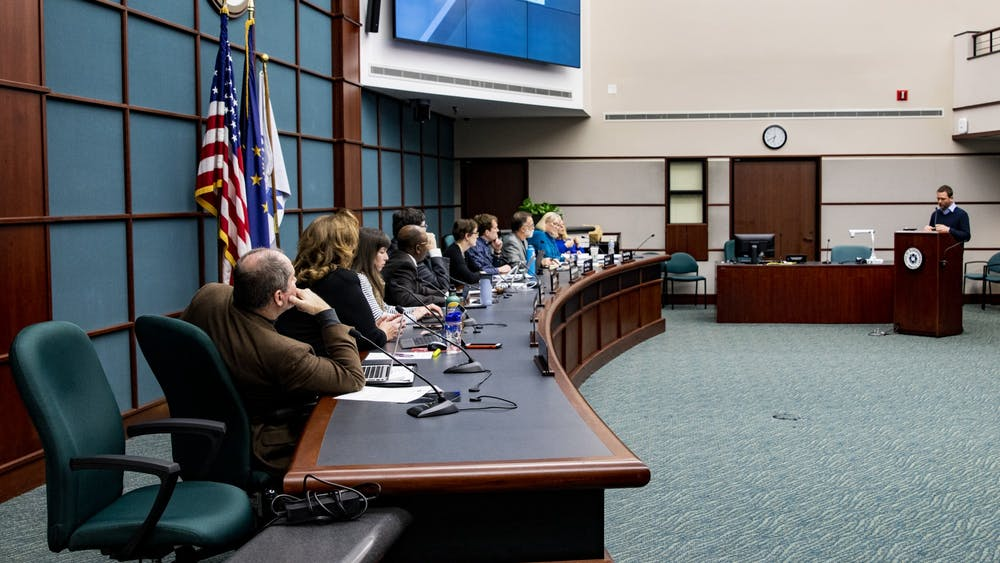 Director of Public Works Adam Wason speaks to city council members Jan. 15 in City Hall. The Bloomington City Council unanimously passed an oridance transitioning from public housing.