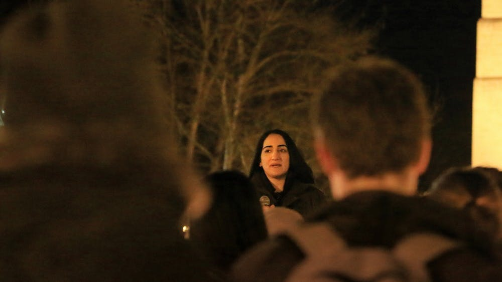 Zahra Ayoubi, Mustafa Ayoubi's sister, speaks March 6 during a vigil for Mustafa organized by the Muslim Student Association at IU at Showalter Fountain. Mustafa was an IU graduate who was killed in what some believe was a hate crime.