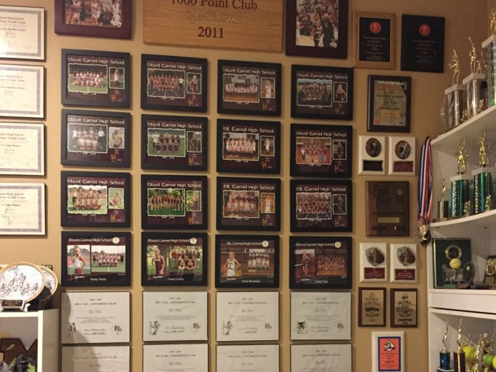 In senior guard Tyra Buss' basement at her home in Mount Carmel, Illinois, is a showcase of all her accomplishments from when she was kid to her most recent successes at IU.