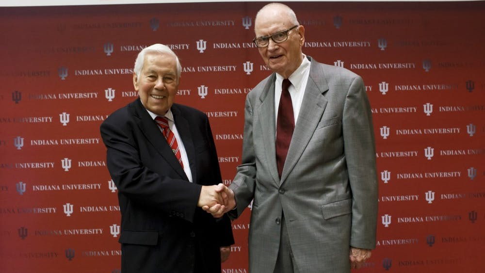 Richard G. Lugar, left, and Lee H. Hamilton, right, shake hands at the announcement in October of the naming of IU's Hamilton Lugar School of Global and International Studies. Lugar died Sunday at 87.
