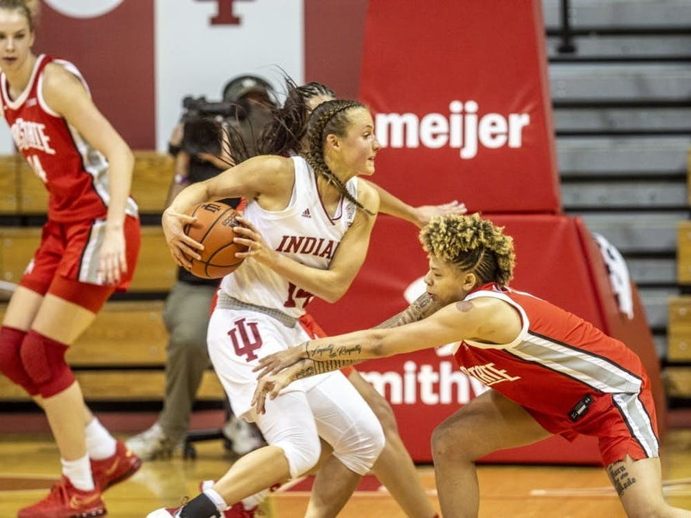Redshirt senior guard Ali Patberg moves the ball around an Ohio State defender Jan. 28 in Simon Skjodt Assembly Hall. Patberg had 16 points on Sunday in IU's 58-50 win over Illinois.